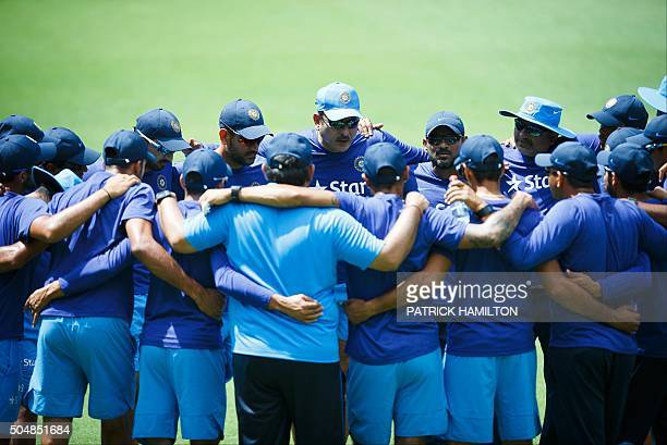 India's team director Ravi Shastri speaks with his players during a cricket training session in Brisbane on January 14 2016 AFP PHOTO / PATRICK...