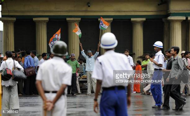 India's Trinamool Congress Party supporters stand outside a counting centre where hundreds of polling officers of the Election Commission of India...