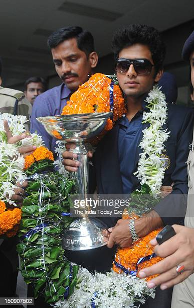 India's triumphant under19 World Cup captain Unmukt Chand with the trophy at the Mumbai airport on Tuesday August 28 2012