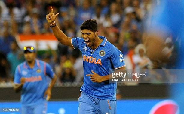 India's Umesh Yadav celebrates after taking the wicket of Bangladesh's Tamim Iqbal during the 2015 Cricket World Cup quarterfinal match between India...