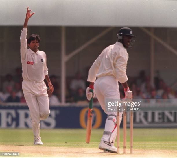 India's Venkatesh Prasad has England's Chris Lewis caught in the slips