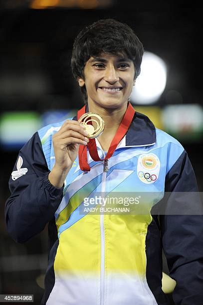 India's Vinesh poses with her gold medal after winning the Women's Freestyle 48kg Wrestling competition at the 2014 Commonwealth Games in Glasgow...