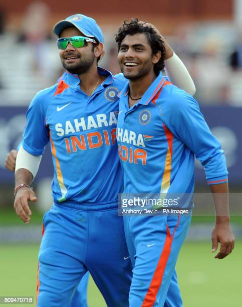 India's Virat Kholi celebrates with Ravindra Jadeja after he took the wicket of England's Ian Bell during the Fourth ODI at Lords Cricket Ground...