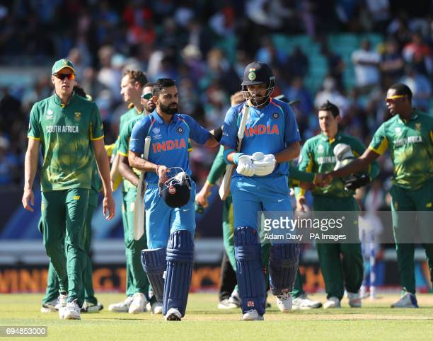 India's Virat Kohl and Yuvraj Singh walk off at the end after beating South Africa in the ICC Champions Trophy Group B match at The Oval London
