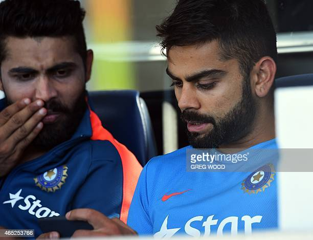 India's Virat Kohli and Ravindra Jadeja relax after completing a final training session ahead of the 2015 Cricket World Cup Pool B match between the...