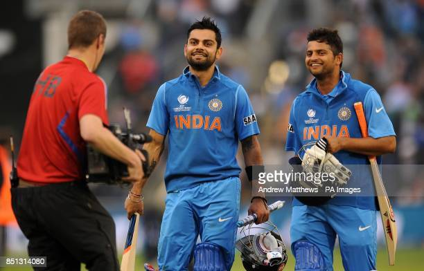 India's Virat Kohli and Suresh Raina are all smiles as they leave the field of play after their side win the ICC Champions Trophy Semi Final at the...