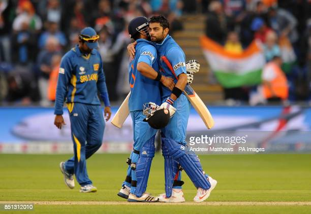 India's Virat Kohli and Suresh Raina embrace after their side win the ICC Champions Trophy Semi Final at the SWALEC Stadium Cardiff