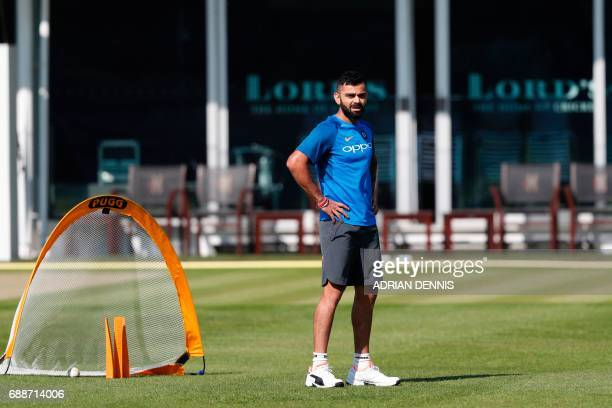 India's Virat Kohli attends a practice session at Lord's Cricket Ground in London on May 26 2017 ahead of the start of the 2017 2017 ICC Champions...