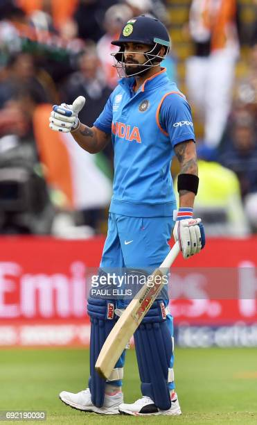 India's Virat Kohli bats during the ICC Champions trophy match between India and Pakistan at Edgbaston in Birmingham on June 4 2017 / AFP PHOTO /...