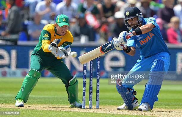 India's Virat Kohli bats watched by South Africa's AB de Villiers during the 2013 ICC Champions Trophy cricket match between India and South Africa...