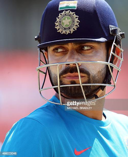 India's Virat Kohli gets ready to bat during a training session ahead of their 2015 Cricket World Cup Group B match against Zimbabwe in Auckland on...