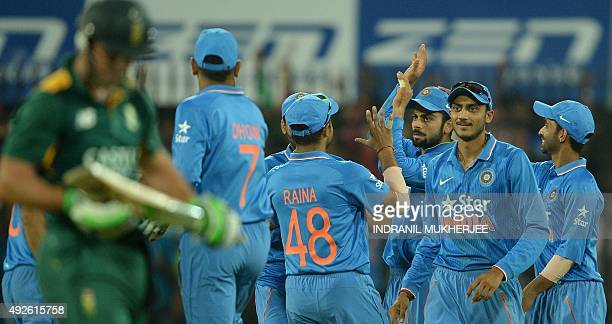India's Virat Kohli is congratulated by teammates after taking a catch for the dismissal of South Africa's captain AB de Villiers during the second...