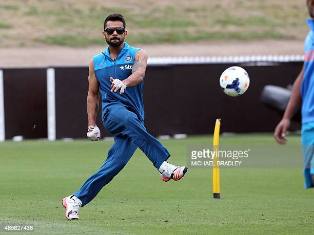 India's Virat Kohli plays football during a cricket training session ahead of their 2015 Cricket World Cup Group B match against Ireland in Hamilton...