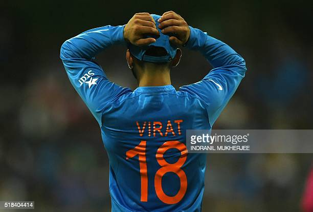 India's Virat Kohli reacts after a not out decision against West Indies's Lendl Simmons during the World T20 men's semifinal match between India and...