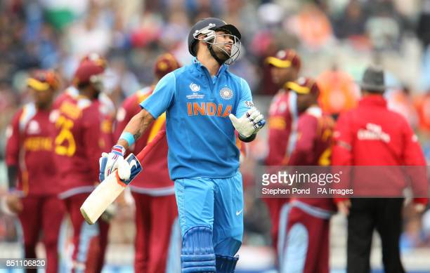India's Virat Kohli reacts after being dismissed during the ICC Champions Trophy match at the Kia Oval London
