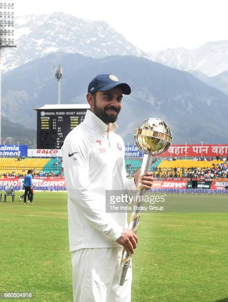 India's Virat Kohli receives the ICC Test Mace after India won the test series against Australia during the day 4 of their fourth test cricket match...