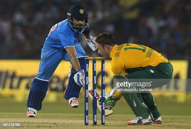India's Virat Kohli runs to reach the crease as South Africa's AB de Villiers runs him out during the second T20 cricket match between India and...