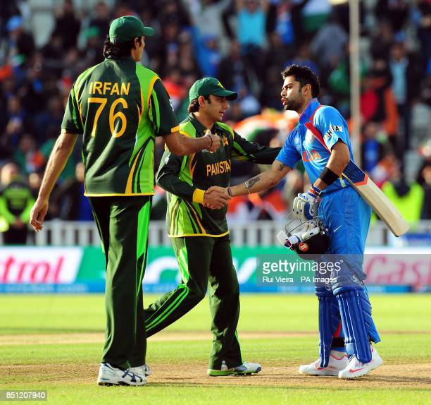 India's Virat Kohli shakes hands with Saeed Ajmal and Mohammad Irfan after hitting the winning run during the ICC Champions Trophy match at Edgbaston...