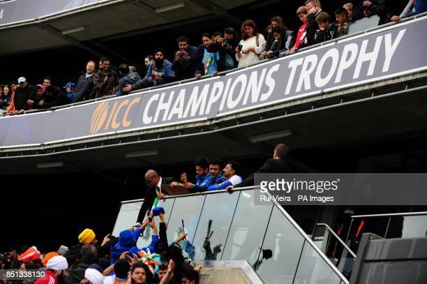 India's Virat Kohli signs autographs as rain delays play during the ICC Champions Trophy Final at Edgbaston Birmingham
