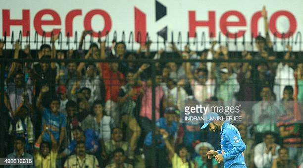 India's Virat Kohli smiles after taking a catch for the dismissal of South Africa's Dale Steyn during the second one day international cricket match...