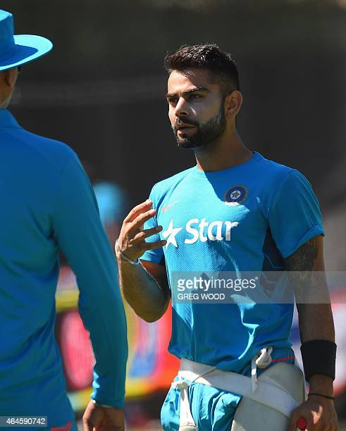 India's Virat Kohli takes a break from batting during a final training session ahead of their Pool B 2015 Cricket World Cup match against the United...