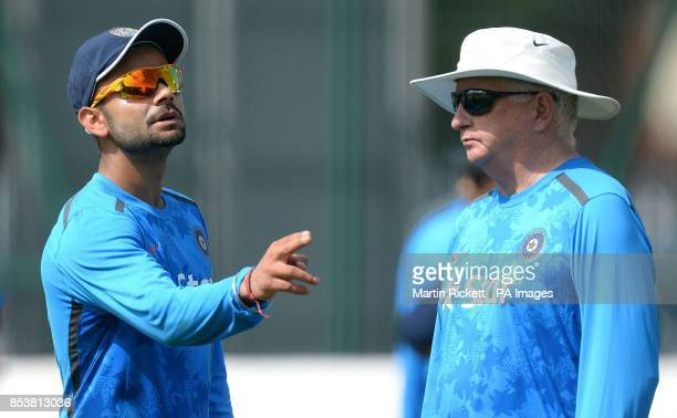 India's Virat Kohli talks with coach Duncan Fletcher during a nets practice session at Emirates Old Trafford Manchester