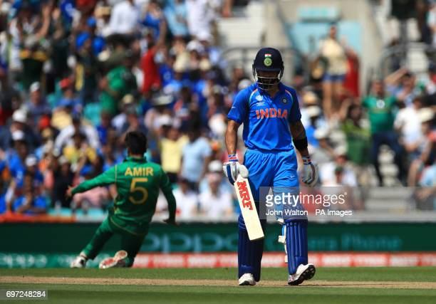 India's Virat Kohli walks off during the ICC Champions Trophy final at The Oval London