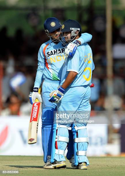 India's Virender Sehwag and Gautam Gambhir celebrate their 100 partnership during The First One Day International at Madhavrao Scindia Cricket Ground...