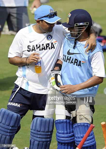 India's Virender Sehwag and Gautam Gambhir talk during a cricket training session at The Barabati Stadium in Cuttack on November 28 2011 Indian will...
