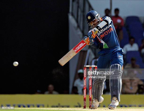India's Virender Sehwag bats in the Second One Day International match between India and Australia at the Vidarbha Cricket Association Stadium on...