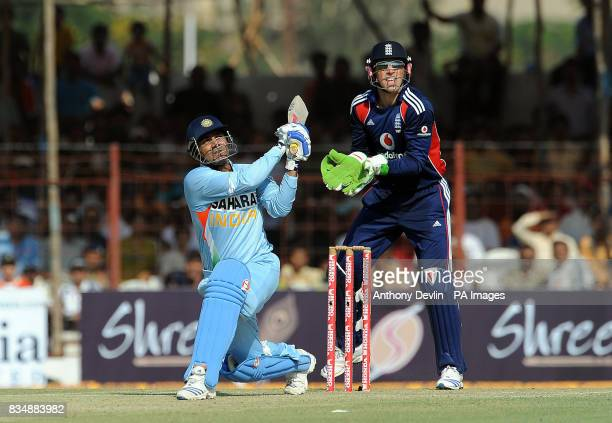 India's Virender Sehwag hits a six of England's Paul Collingwood's second ball during The First One Day International at Madhavrao Scindia Cricket...