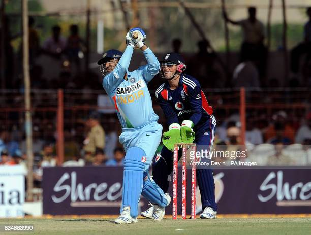 India's Virender Sehwag hits a six of England's Paul Collingwood's first ball during The First One Day International at Madhavrao Scindia Cricket...