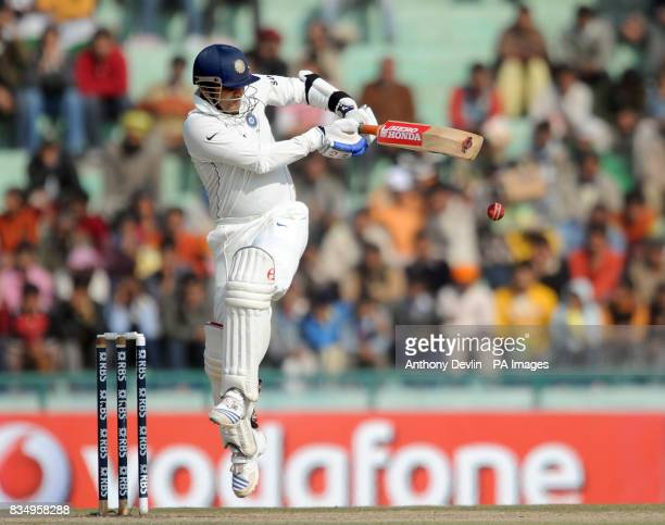 India's Virender Sehwag hitsout during the fourth day of the second test at the Punjab Cricket Association Stadium Mohali India
