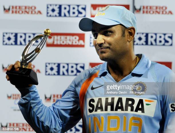 India's Virender Sehwag holds a trophy following the Fourth One Day International at M Chinnaswamy Stadium Bangalore India