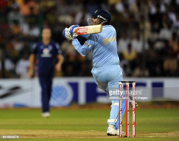 India's Virender Sehwag reached his half century during the Fourth One Day International at M Chinnaswamy Stadium Bangalore India