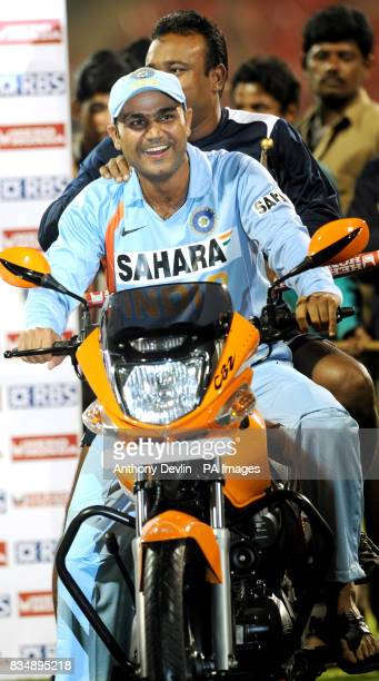 India's Virender Sehwag rides a motorbike following the Fourth One Day International at M Chinnaswamy Stadium Bangalore India