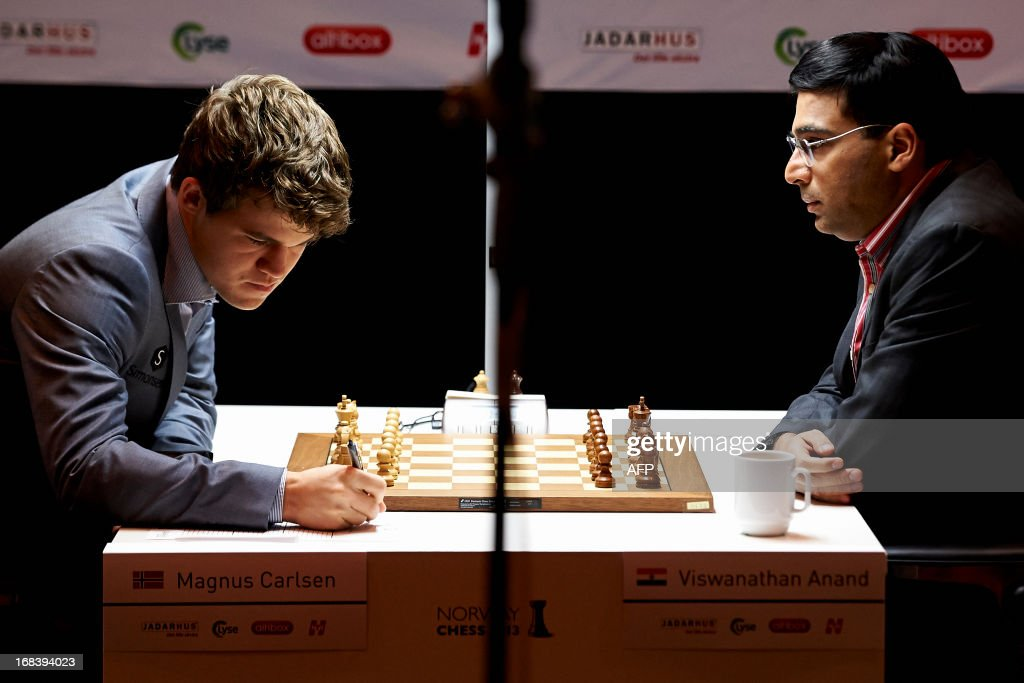 India`s Viswanathan Anand (R) plays against Norway`s Magnus Carlsen during the Norway Chess 2013 Blitz tournament in Sandnes near Stavanger, on May 9, 2013. AFP PHOTO / SCANPIX NORWAY / KENT SKIBSTADT NORWAY OUT