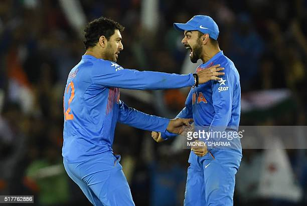 India's Vuvraj Singhcelebrates with teammate Vurat Kohli after his dismissal of Australia's Steve Smith during the World T20 cricket tournament match...