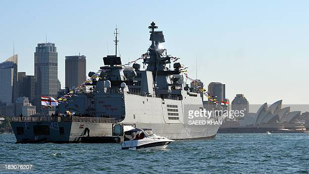 India's warship INS Sahyadri docks at the Sydney Harbour in front of the iconic Sydney Opera House on October 4 2013 Ships from nations including...