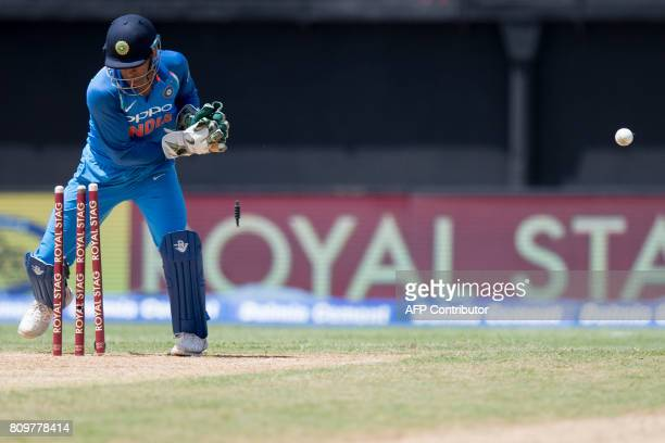 India's Wicket Keeper Mahindra Singh Dhoni tries to catch the ball during the fifth One Day International match between West Indies and India at the...