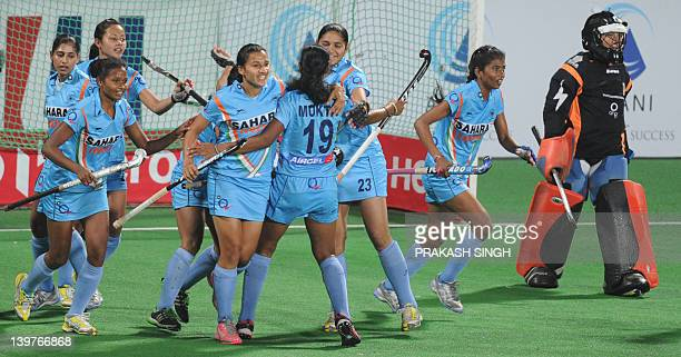 India's women hockey players celebrate a goal during the women's field hockey match between India and Italy of the FIH London 2012 Olympic Hockey...