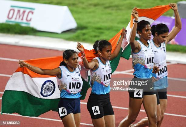 India's women's 4 x 400m relay team celebrates placing first during the final day of the 22nd Asian Athletics Championships on July 9 2017 at Kalinga...