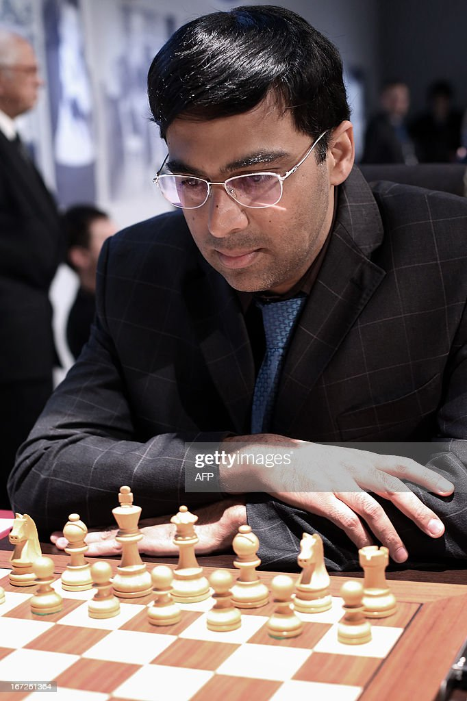India's world champion Viswanathan Anand concentrates prior to play his first move during a round 3 game of the Alekhine Memorial chess tournament on April 23, 2013 in Paris. The tournament is a 10-player single round competition, with the first half held in Paris from April 20 to 25, and the second half in the Russian State Museum in St. Petersburg from April 26 to May 1st.