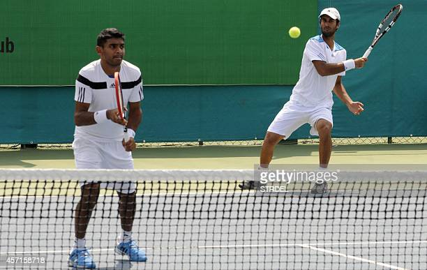 India's Yuki Bhambri and Divij Sharan play against Italy's duo Riccardo Ghedin and Stefano Travaglia on the opening day of Indore Open ATP Challenger...