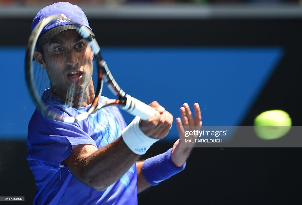 India's <a gi-track='captionPersonalityLinkClicked' href=/galleries/search?phrase=Yuki+Bhambri&family=editorial&specificpeople=4835849 ng-click='$event.stopPropagation()'>Yuki Bhambri</a> hits a return against Britain's Andy Murray during their men's singles match on day one of the 2015 Australian Open tennis tournament in Melbourne on January 19, 2015.
