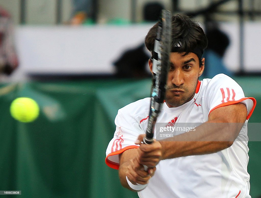 India's Yuki Bhambri plays a shot against Indonesia's Wishnu Adi Nugroho during the Asia/Oceania Zone Group I Davis Cup singles play-off match at KSLTA stadium in Bangalore on April 7, 2013. AFP PHOTO/ STR