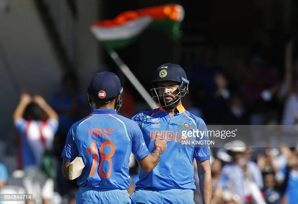 India's Yuvraj Singh and India's captain Virat Kohli celebrate after winning the ICC Champions Trophy match between South Africa and India at The...