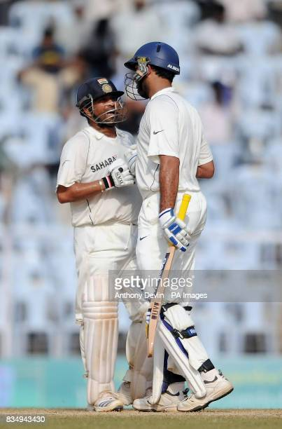 India's Yuvraj Singh and Sachin Tendulkar celebrate a partnership of 100 during the fifth day of the First Test Match at the M A Chidambaram Stadium...