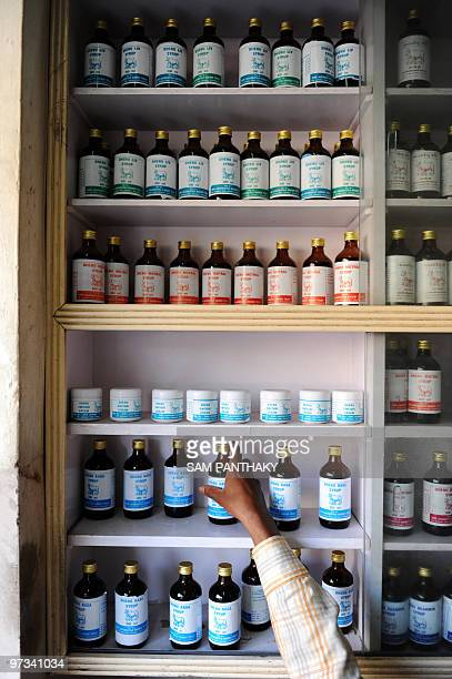 IndiasciencemedicineresearchcowsFEATURE by Rupam Jain Nair This photo taken on February 27 2010 shows storekeeper Pappu Yadav picking out a bottle of...