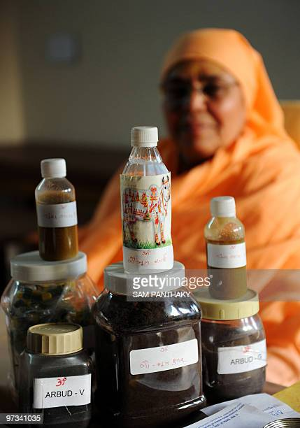 IndiasciencemedicineresearchcowsFEATURE by Rupam Jain Nair This photo taken on February 27 2010 shows Shree Maa Anantanand sitting behind medicine...
